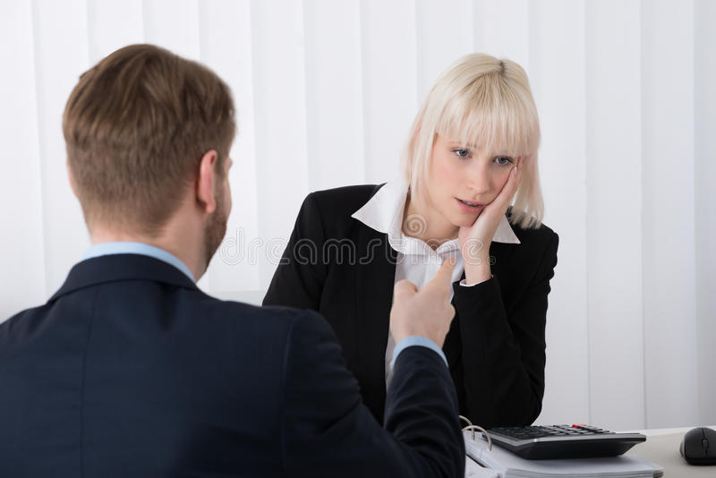 Boss Blaming Female Employee For Bad Results royalty free stock photos