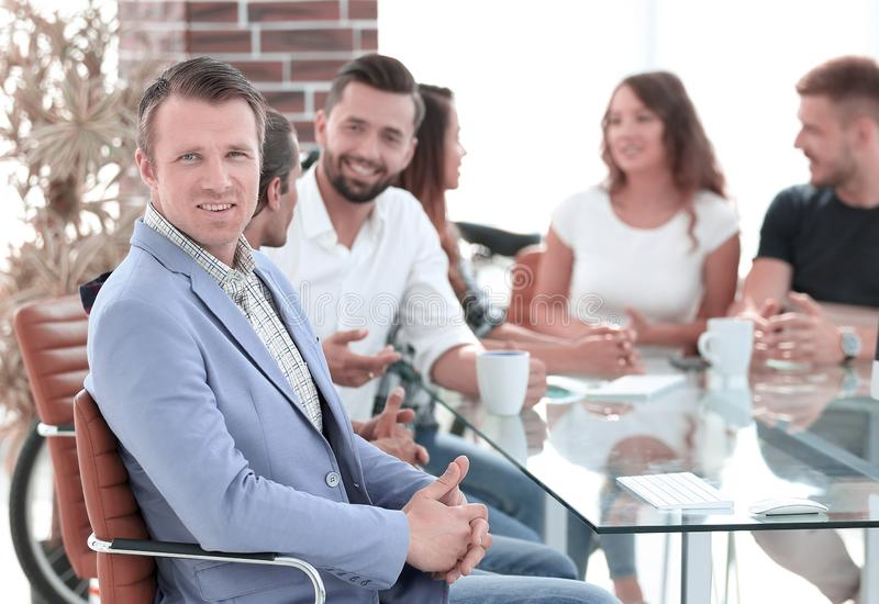 Boss and business team on meeting in office stock photography