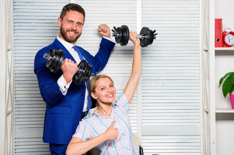 Boss businessman manager raise hand with dumbbells. Strong business team. Healthy habits in office. Key to success royalty free stock photography