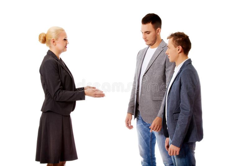 Boss businesswoman screaming at her employees stock photos