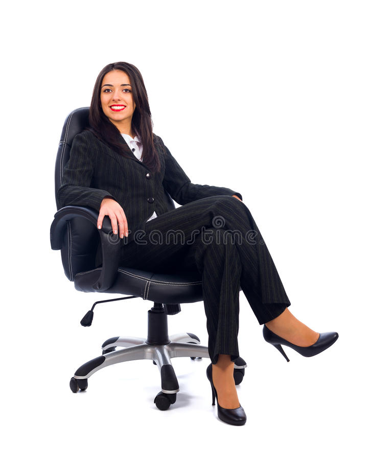 Boss in Chair. Kind boss woman sitting in office chair smiling stock photos
