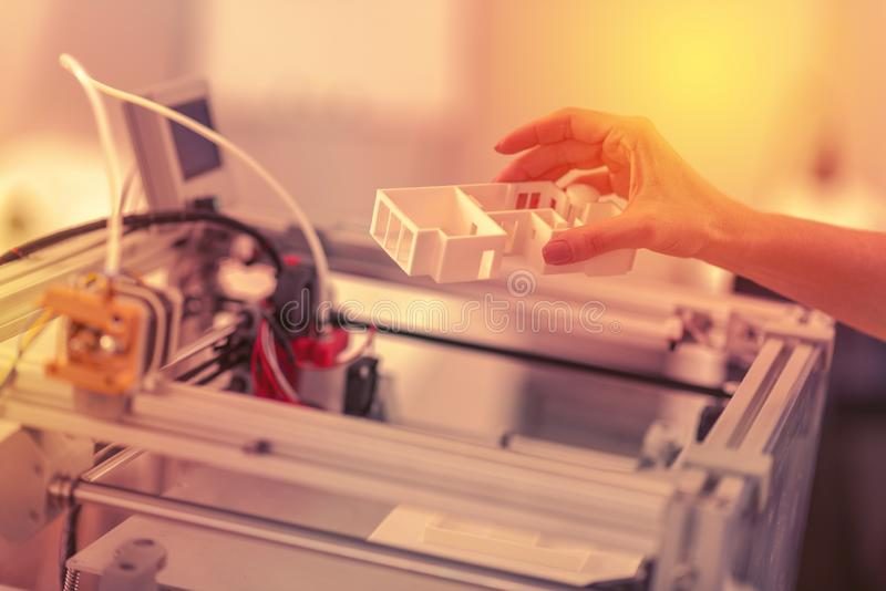 Boss of the company checking out a fully functioning 3D printer. stock photo