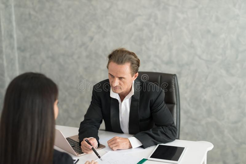 Boss complain to businesswoman employee for mistake on her job, royalty free stock images