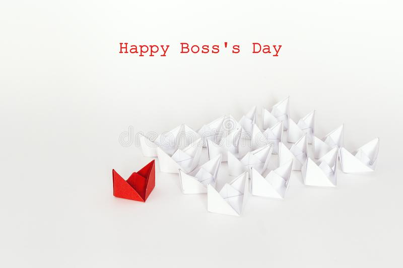 Boss day background with red paper ship leading white boats. Hap royalty free stock photo