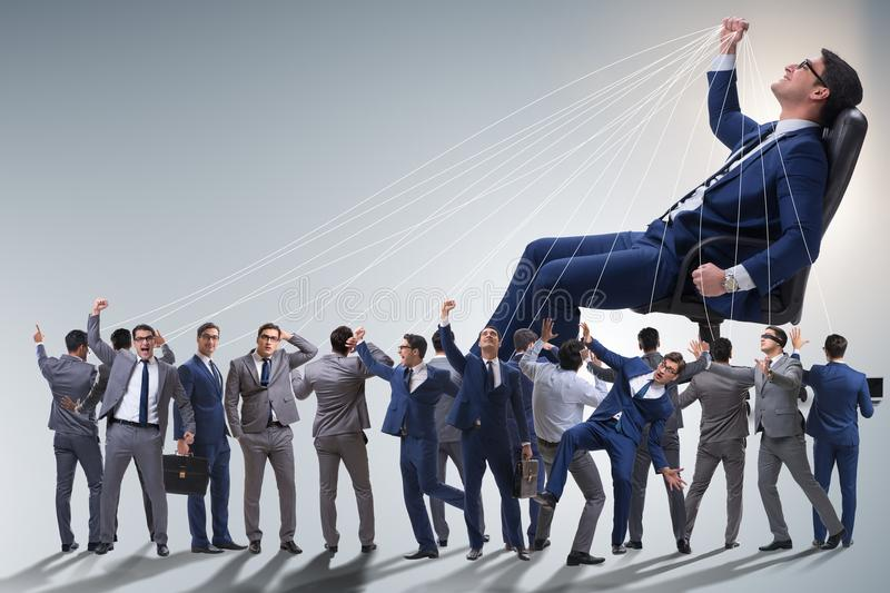 The boss employee manipulating his staff in business concept stock photo
