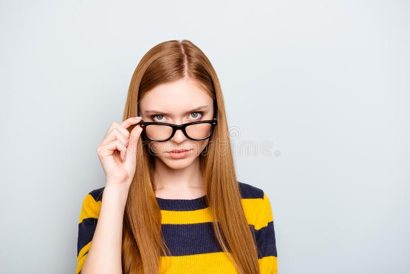 Boss employment university campus knowledge concept. Close up po. Rtrait of confident serious concentrated focused astonished shocked teenager touching glasses royalty free stock photo