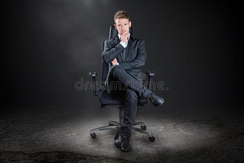 Boss. The Boss on the executive chair stock photography