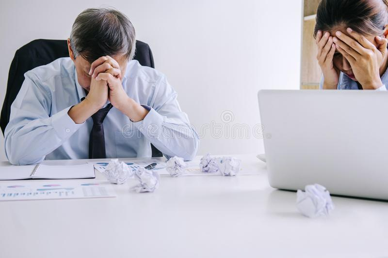 Boss and executive team feeling stress and serious of fail business, partners holding heads in hands depressed by failure and royalty free stock photo