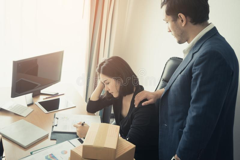 Boss giving Consolation to a stressed office worker royalty free stock photography