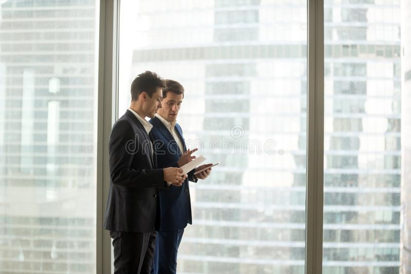 Boss giving instructions to company employee royalty free stock image