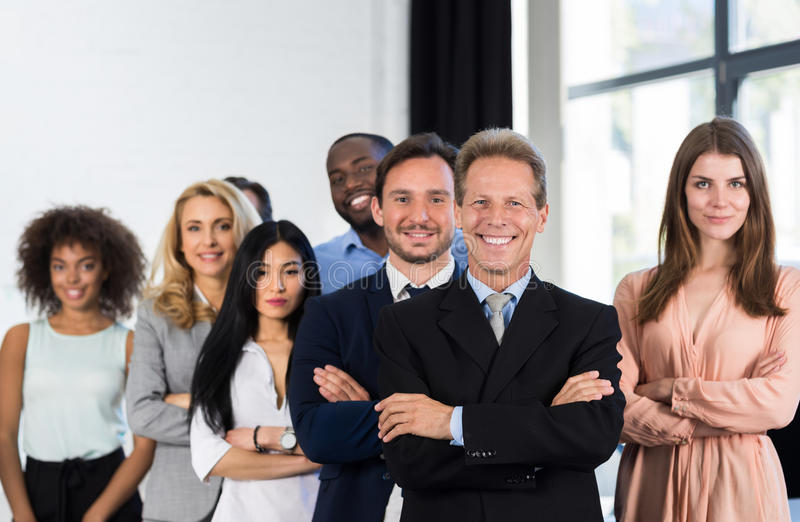 Boss With Group Of Businesspeople In Creative Office, Mature Successful Businessman Leading Business People Team Stand royalty free stock photo