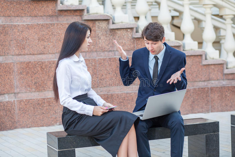 Boss and his assistant discussing their work outdoors. stock photography