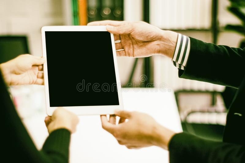 Boss holds tablet in hand secretary look , At party in office, with isolated screen, Impressive concept of digital business royalty free stock photo