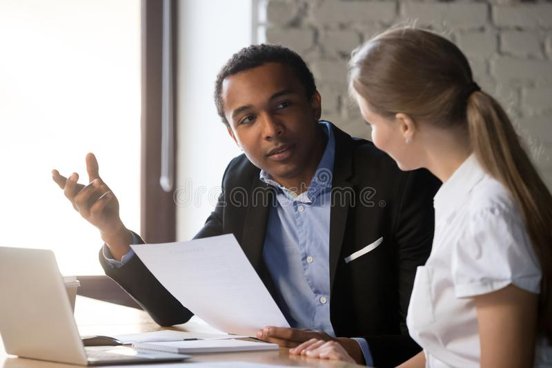 Boss interviewing female candidate, client and manager negotiating royalty free stock image
