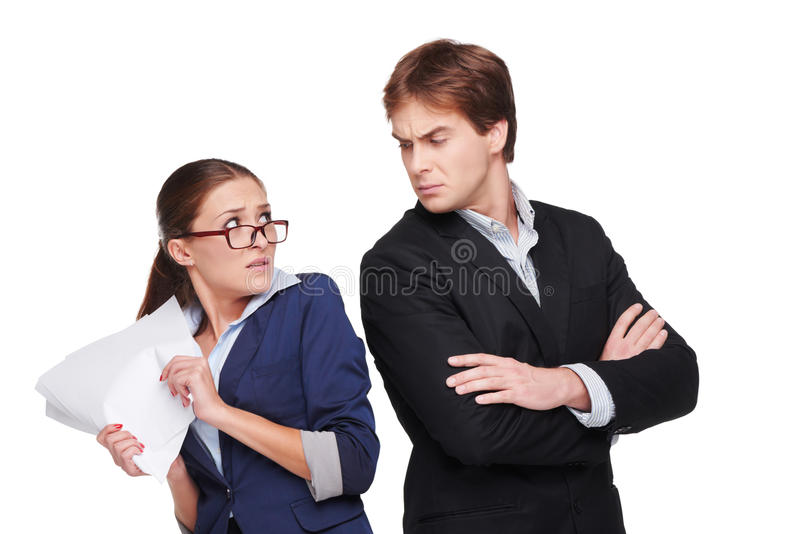 Boss looking strictly at his scared assistant royalty free stock photo