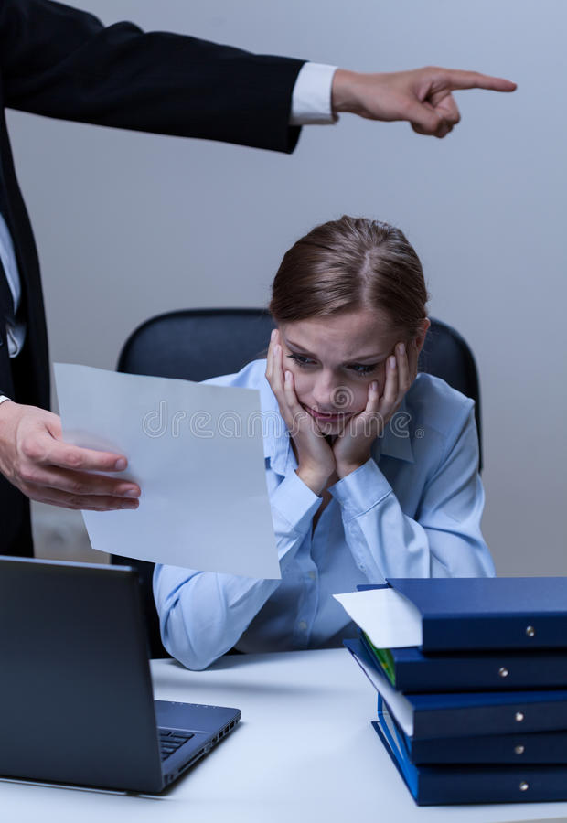 Boss making worker redundant. Vertical view of boss making worker redundant stock photo