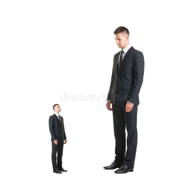 Boss punishing worker over black background. Businessman and subordinate. stock image