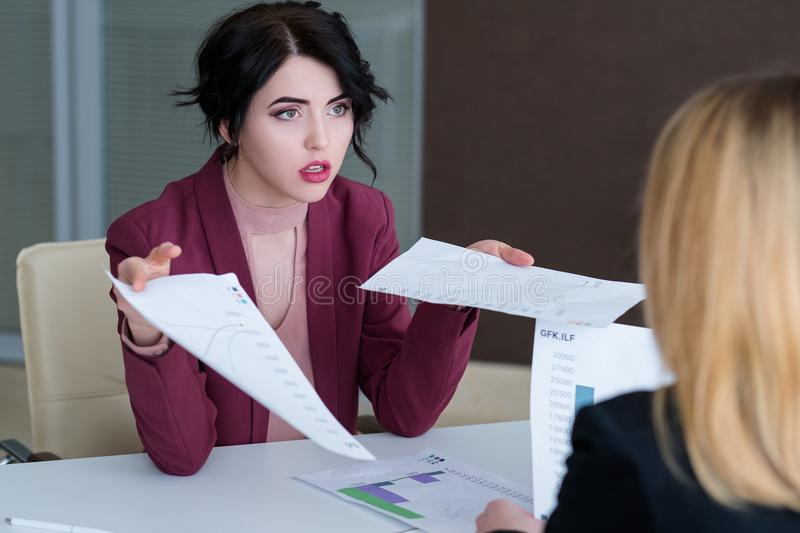 Boss reproach employee business woman reprimand. Boss reproaching her employee. business women getting a reprimand from chief manager. superior and subordinate royalty free stock photos
