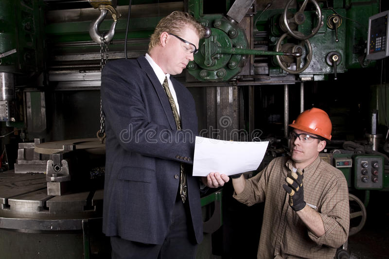 Boss scares worker stock photo