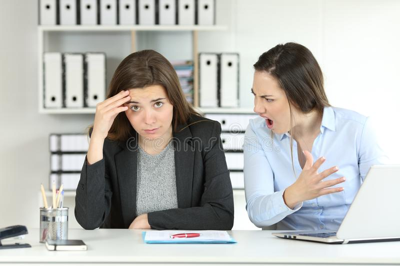 Boss scolding an emlployee looking at camera stock photo