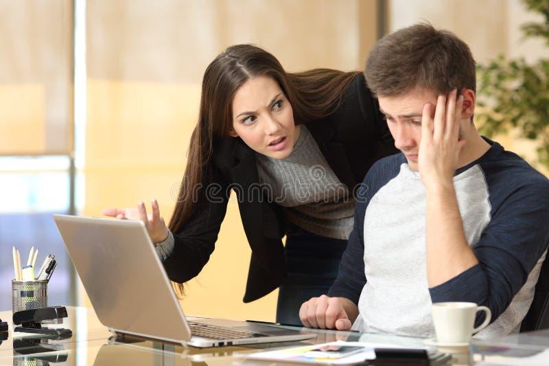 Boss scolding an employee stock images