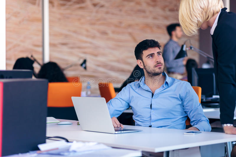 Boss scolding a shameful employee at work in an office stock images
