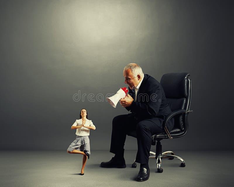 Boss screaming at small meditation woman. Big boss screaming at small meditation woman royalty free stock photos