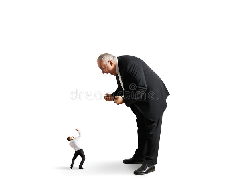 Boss screaming at small startled worker stock images