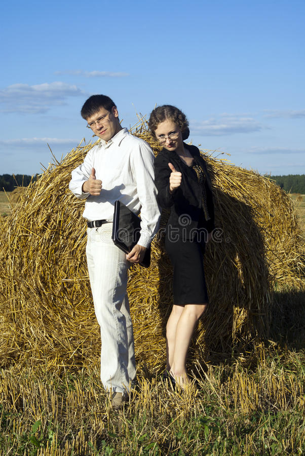 Boss and secretary are glad stock images
