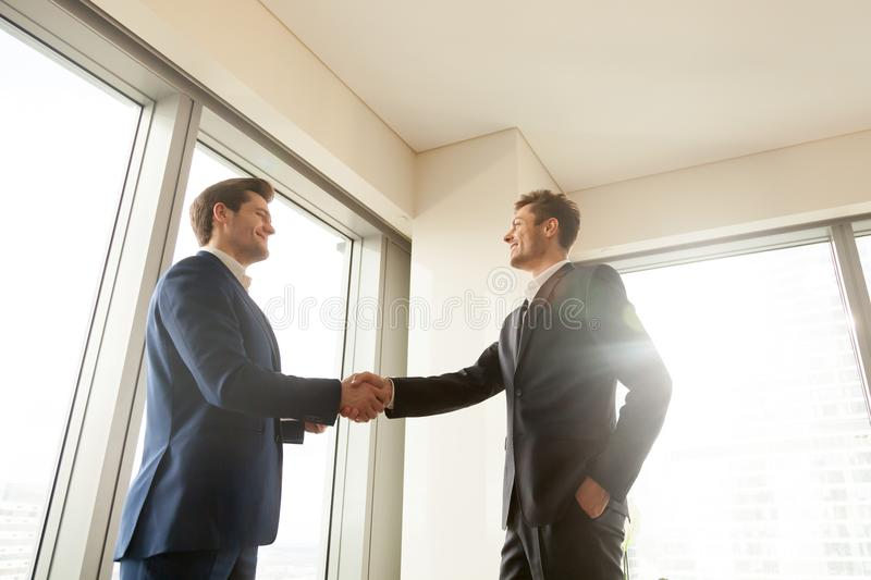 Boss shaking hand and thanking worker for good job royalty free stock photos