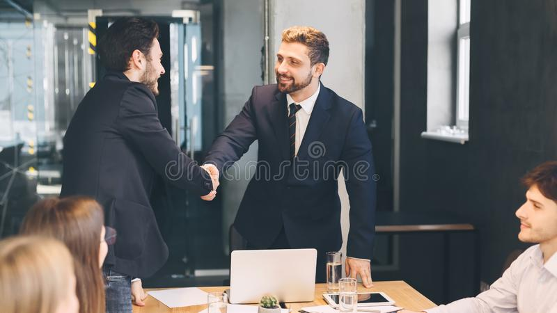 Boss shaking hands with business partner, finishing up meeting royalty free stock photos