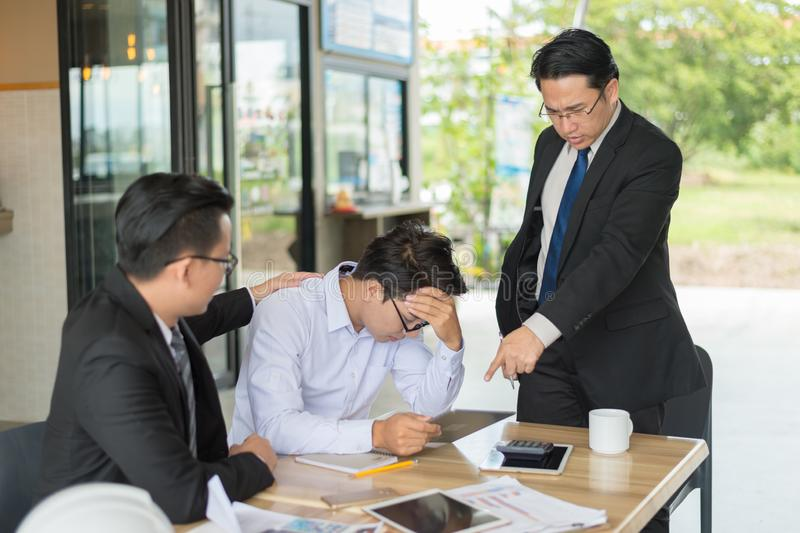Boss shouted to employee and point his finger to reports, he very angry for Reported sales decrease. royalty free stock image