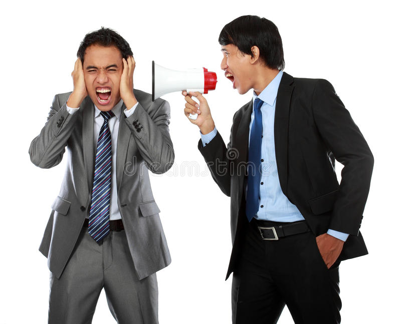 Boss shouting over his employee's ear royalty free stock photography