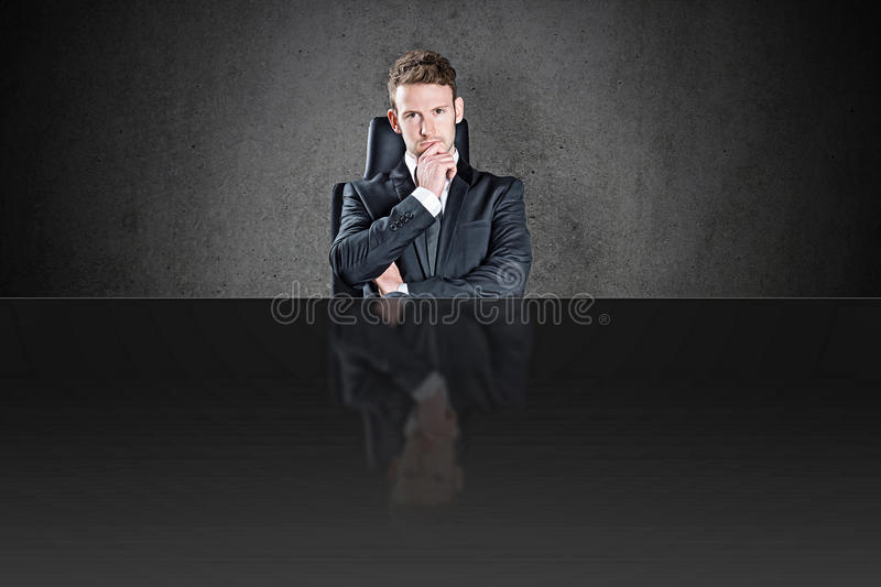 The boss. Sitting on the executive chair royalty free stock photo