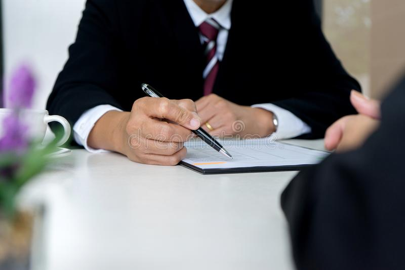 Boss sitting to a new work who just pass. Job interview royalty free stock photos