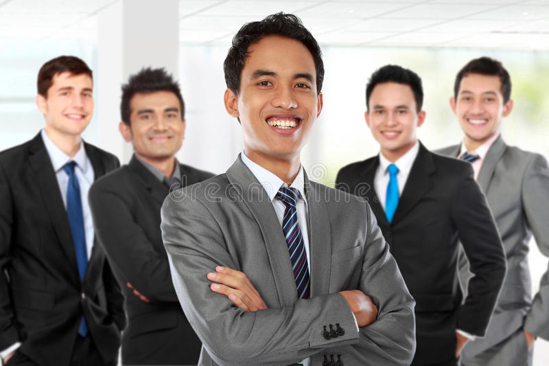 boss standing in front of his team, leading to success stock photo