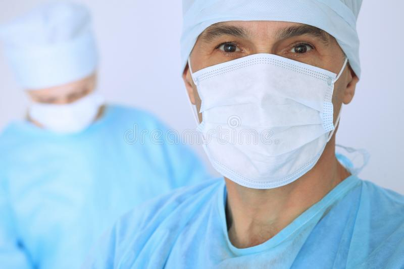 Boss surgeon is examining the operation while medical team are busy of patient. Medicine, healthcare and emergency in. Hospital royalty free stock photos