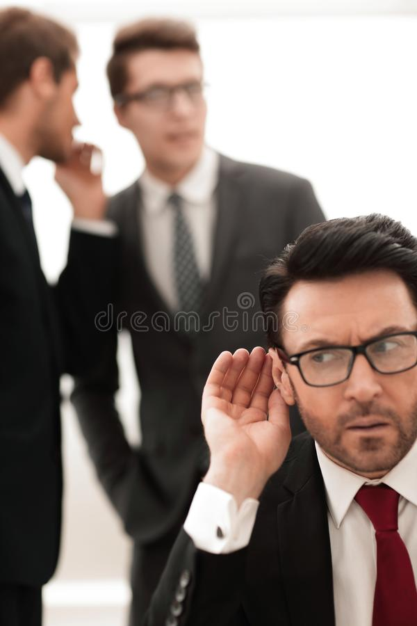Boss is trying to hear gossip royalty free stock photography