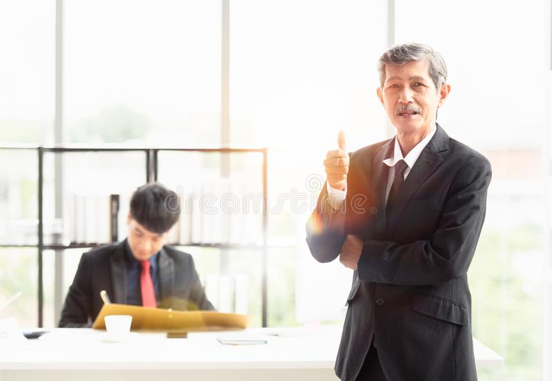 The boss was proud to have an excellent staff. The boss businessman stood and smiled in front. He is proud to have an excellent staff member working in the royalty free stock images