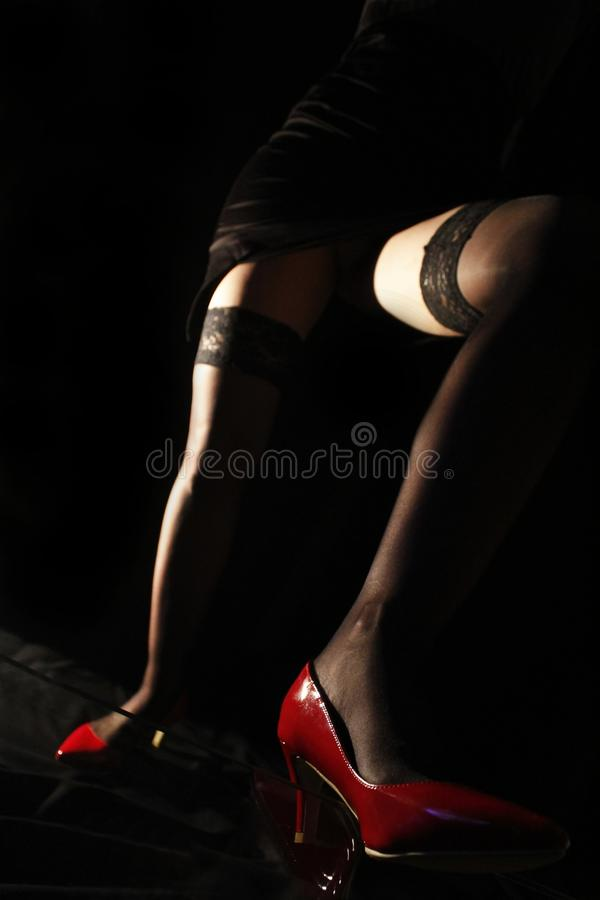 She is the boss. Woman legs in black stockings and red shoes. attractive, beautiful, beauty, boss, bossing, diva, elegance, fashion, female, fetish, floor, girl stock photo