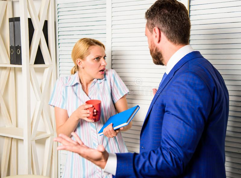 Boss and worker discuss working plan. Office quarrel concept. Misunderstanding between colleagues. Tense conversation or. Quarrel between colleagues. Prejudice royalty free stock photography