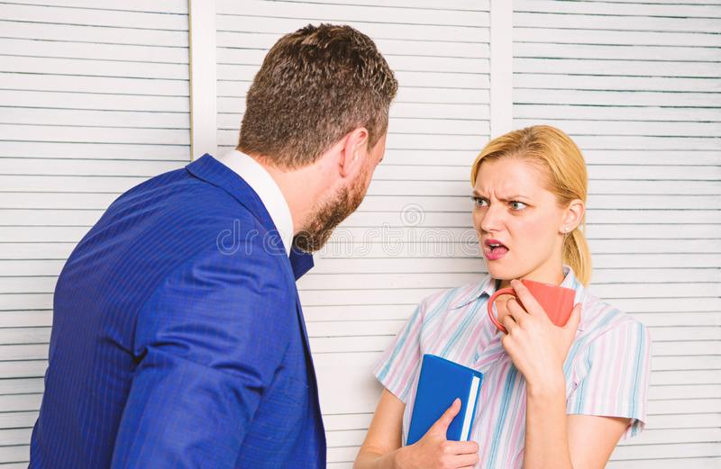 Boss and worker discuss working plan. Prejudice and personal attitude to employee. Office quarrel concept. Misunderstanding between colleagues. Tense royalty free stock photography
