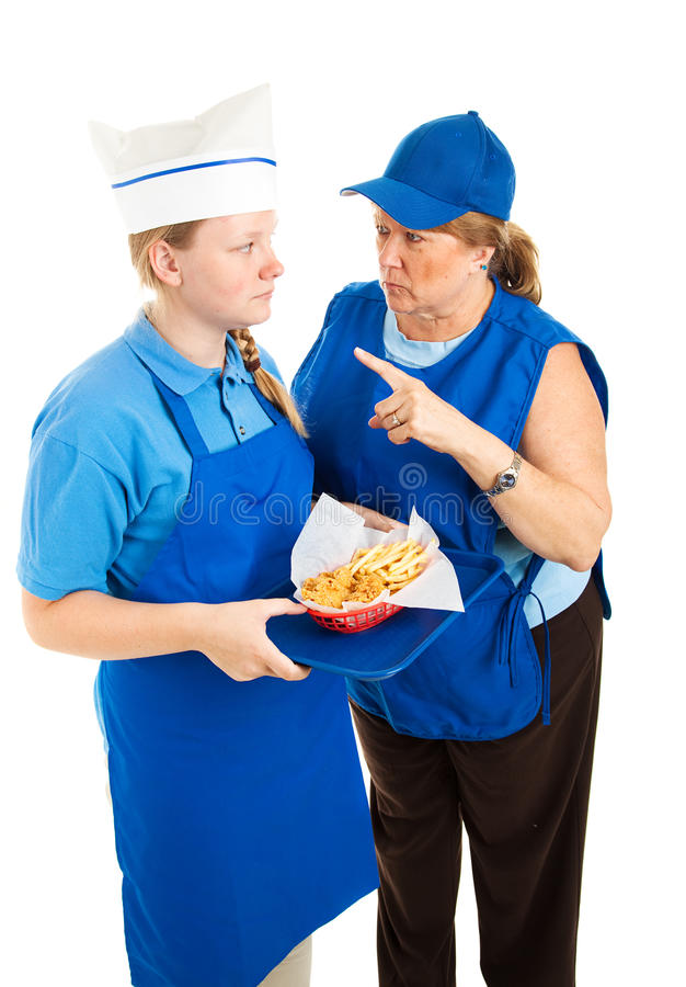 Boss Yells at Fast Food Worker. Boss yells at teenage fast food worker. Isolated on white background royalty free stock photography