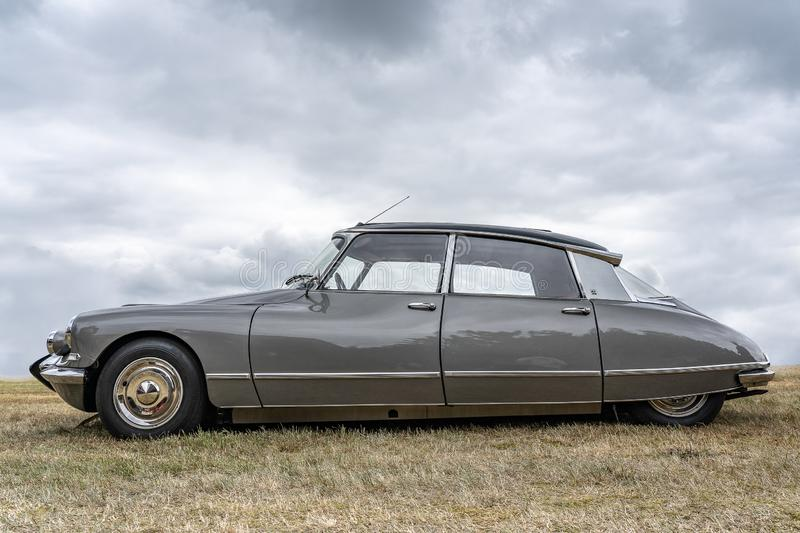 BOSCHENHOOFD/NETHERLANDS-JUNE 11, 2018: side view of a grey classic Citroen DS at a classic car meeting. This is one of the most royalty free stock photos