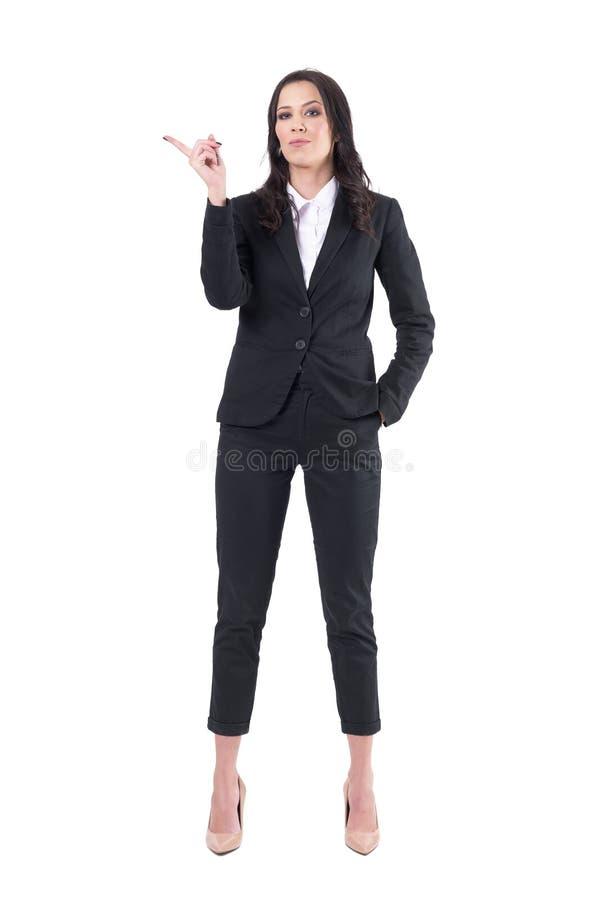 Bossy authoritative business female ceo shaking finger and patronizing. Full body isolated on white background stock photography