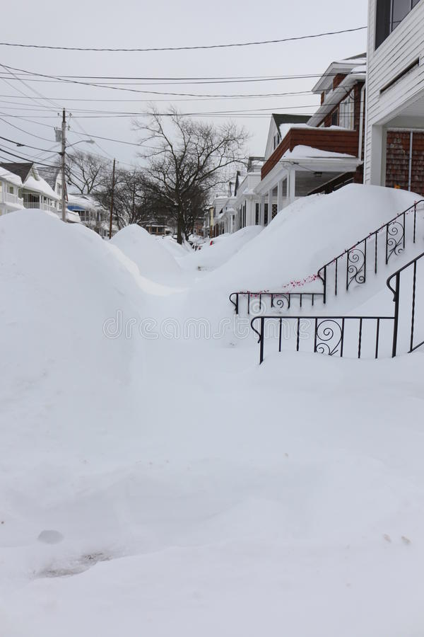 Boston 2015 Blizzard. Boston area snowfall totals at 90 inches or more create snow piles 6-8 feet high on the sidewalks and road sides as communities struggle to stock photography