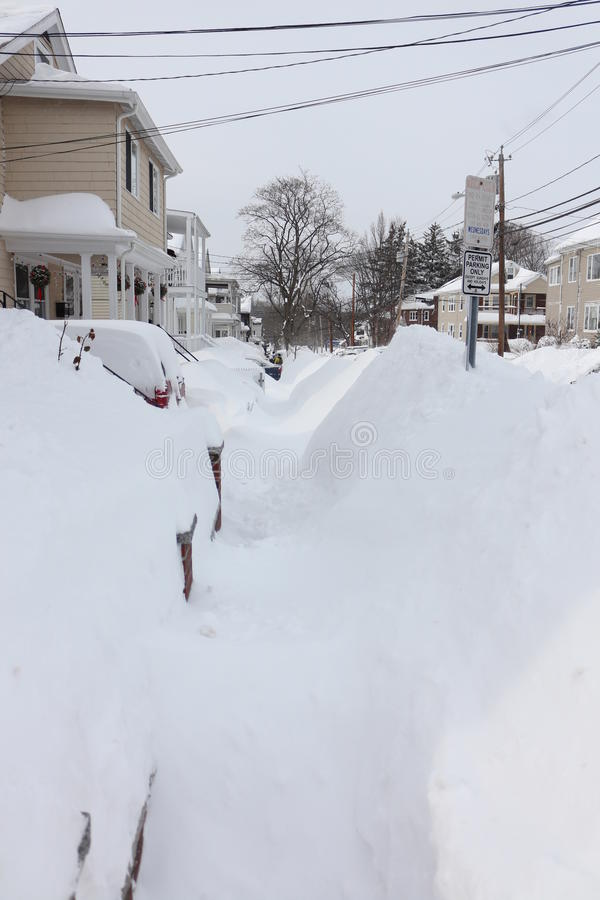 Boston 2015 Blizzard Sidewalks. Boston area snowfall totals at 90 inches or more create snow piles 6-8 feet high on the sidewalks and road sides as communities royalty free stock image