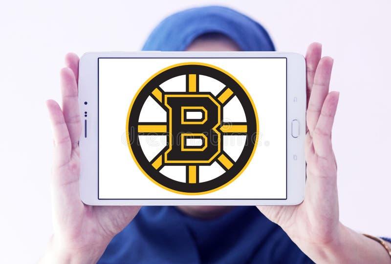 Boston Bruins ice hockey team Club logo. Logo of Boston Bruins ice hockey team Club on samsung tablet holded by arab muslim woman. The Boston Bruins are a royalty free stock photo