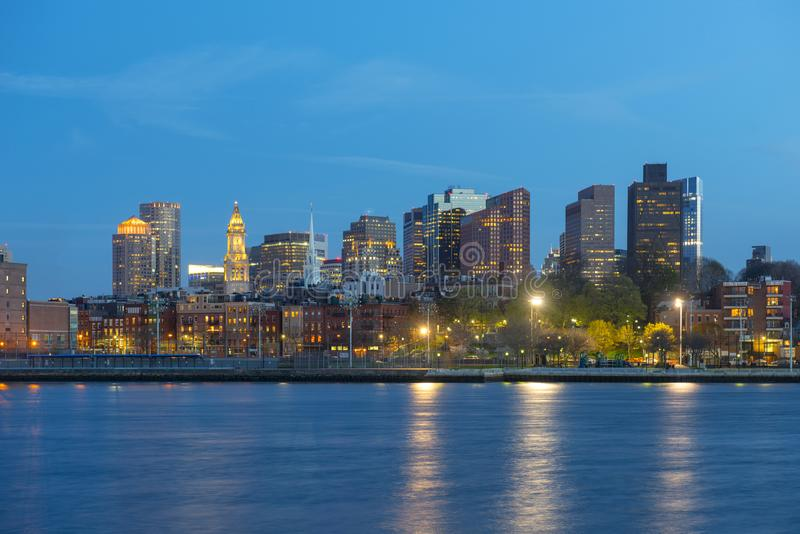 Boston Skyline at night, Massachusetts, USA. Boston City Skyscrapers, Custom House and Boston Waterfront at night from East Boston, Boston, Massachusetts, USA royalty free stock images