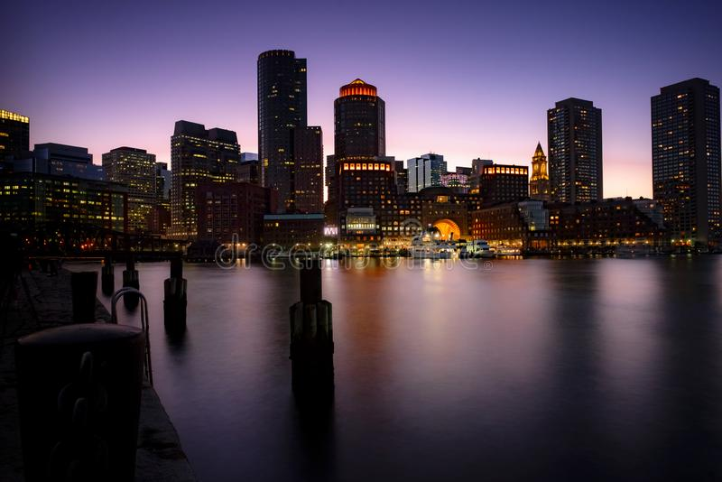 Boston harbor at dusk. View of the boston harbor and the financial district of boston with old and new buildings stock image